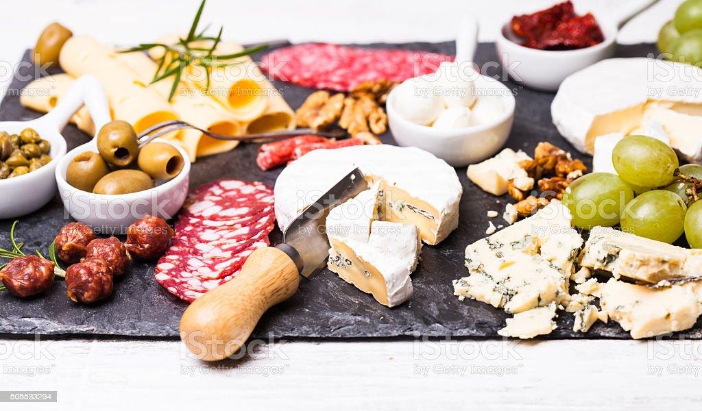 Cheese and salami plate stock photo