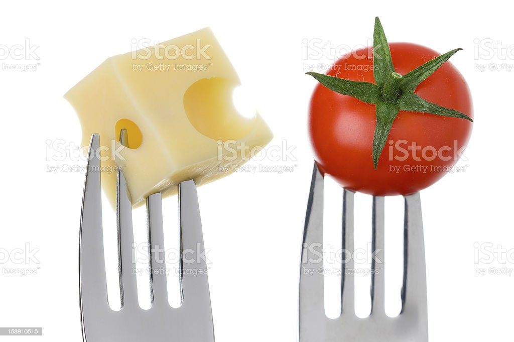 cheese and tomato on forks against white royalty-free stock photo