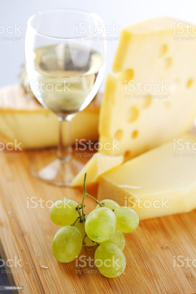 cheese and wine on a wooden table royalty-free stock photo