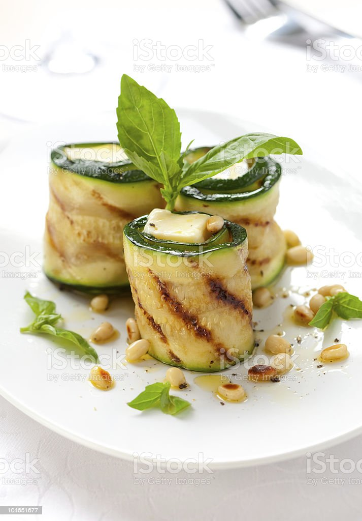 Cheese and zucchini rolls on a white plate royalty-free stock photo