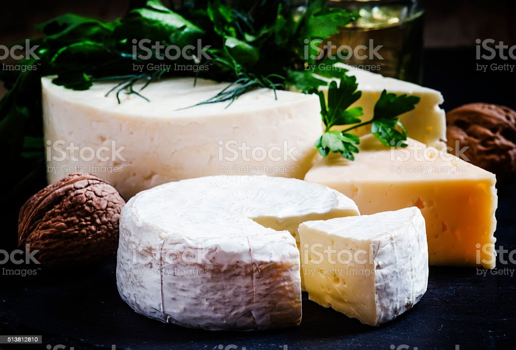 Cheese Assortment on a dark background stock photo