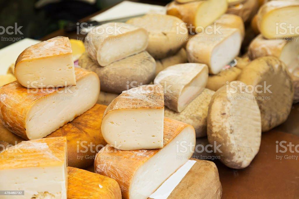 cheese   at market counter stock photo