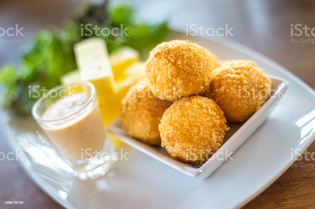 Cheese ball . Garnished on Green Leaf with Nuts Sauce stock photo