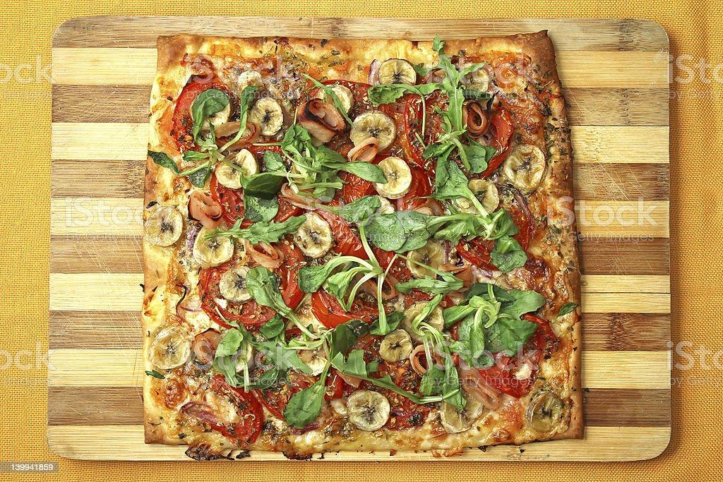 Cheese, banana, ham, onion and arugula Pizza royalty-free stock photo