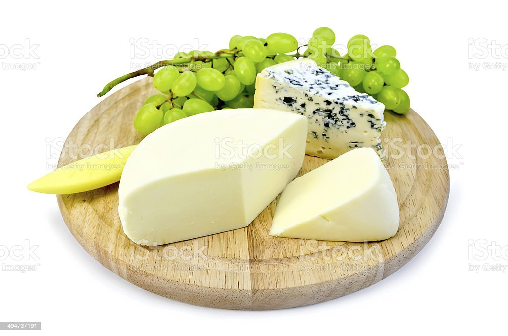 Cheese blue and suluguni on round board stock photo