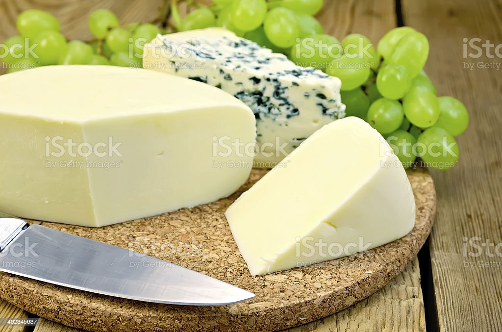 Cheese blue and suluguni on the board stock photo