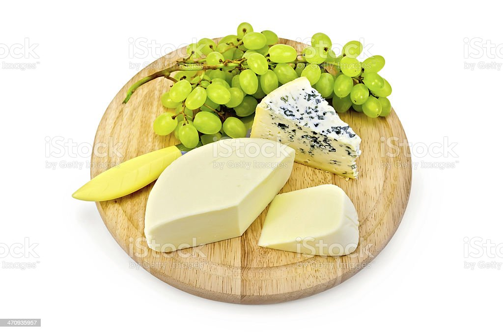 Cheese blue and suluguni with grapes stock photo