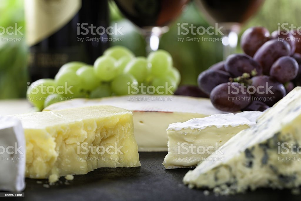 Cheese board and red wine detailed close-up royalty-free stock photo