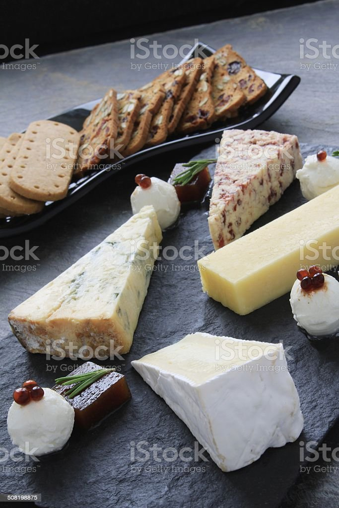 cheese board selection with biscuits stock photo