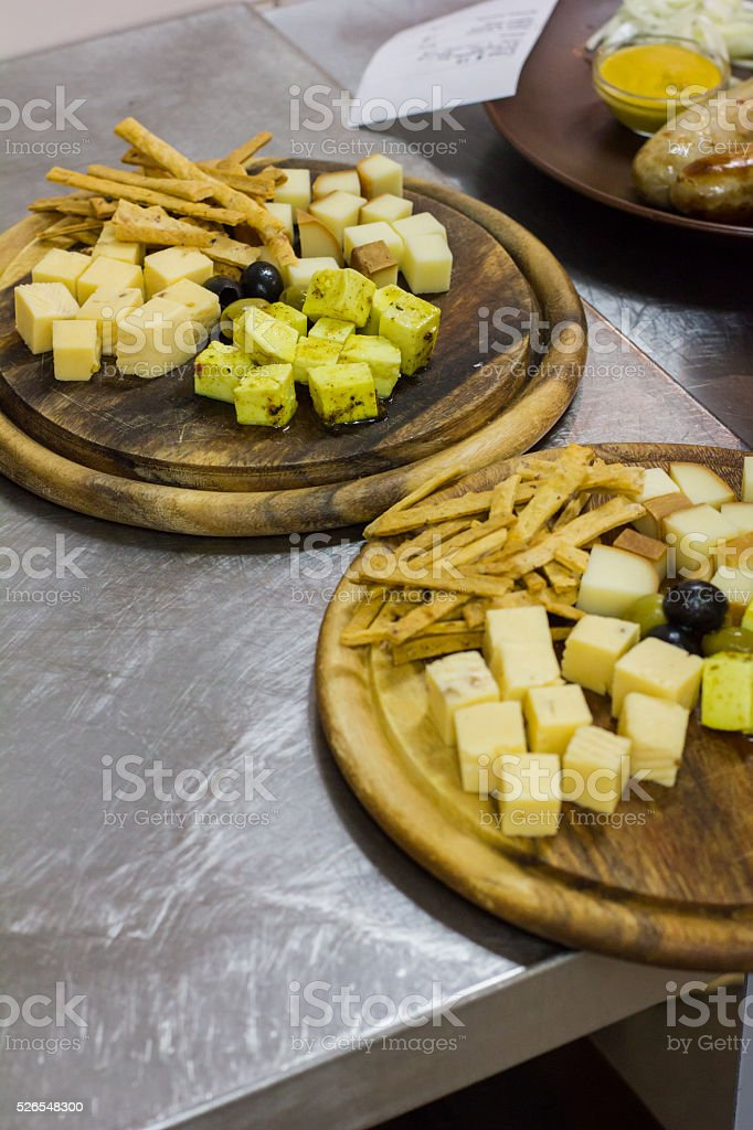 cheese Board with olives. different types of cheese stock photo