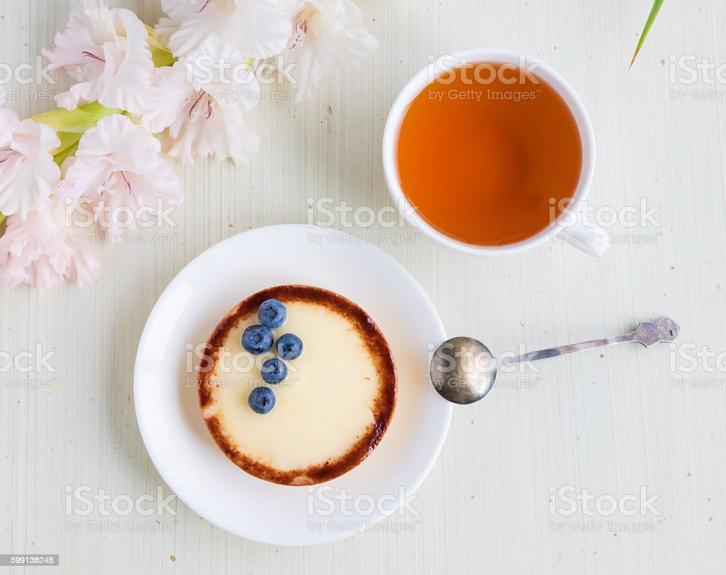 Cheese cake with blueberry and cup of tea, top view stock photo