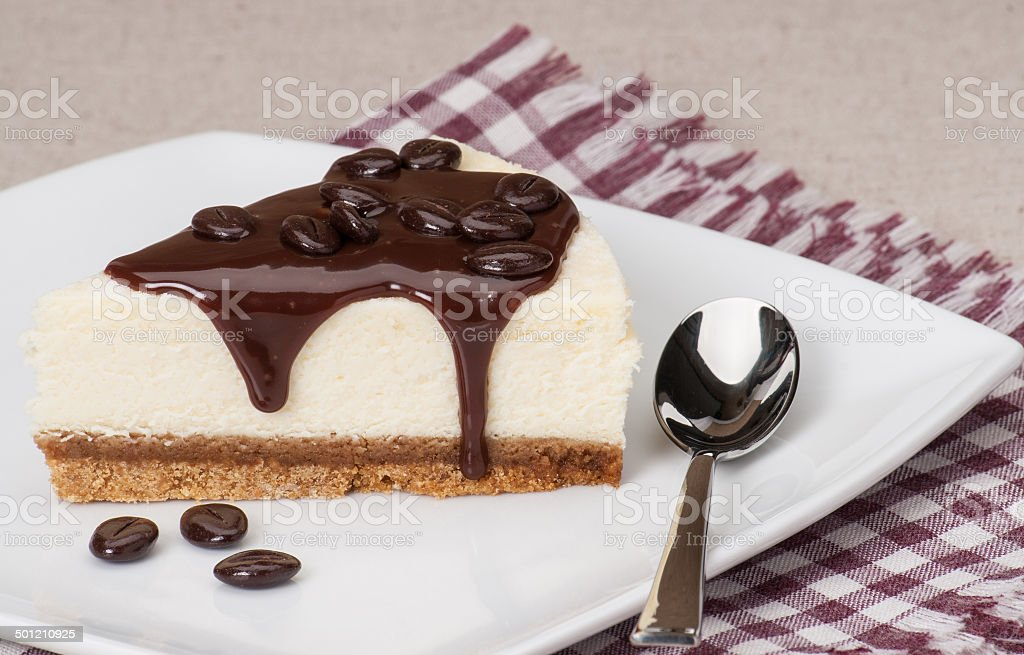 Cheese Cake With Chocolate Sauce On White Plate stock photo