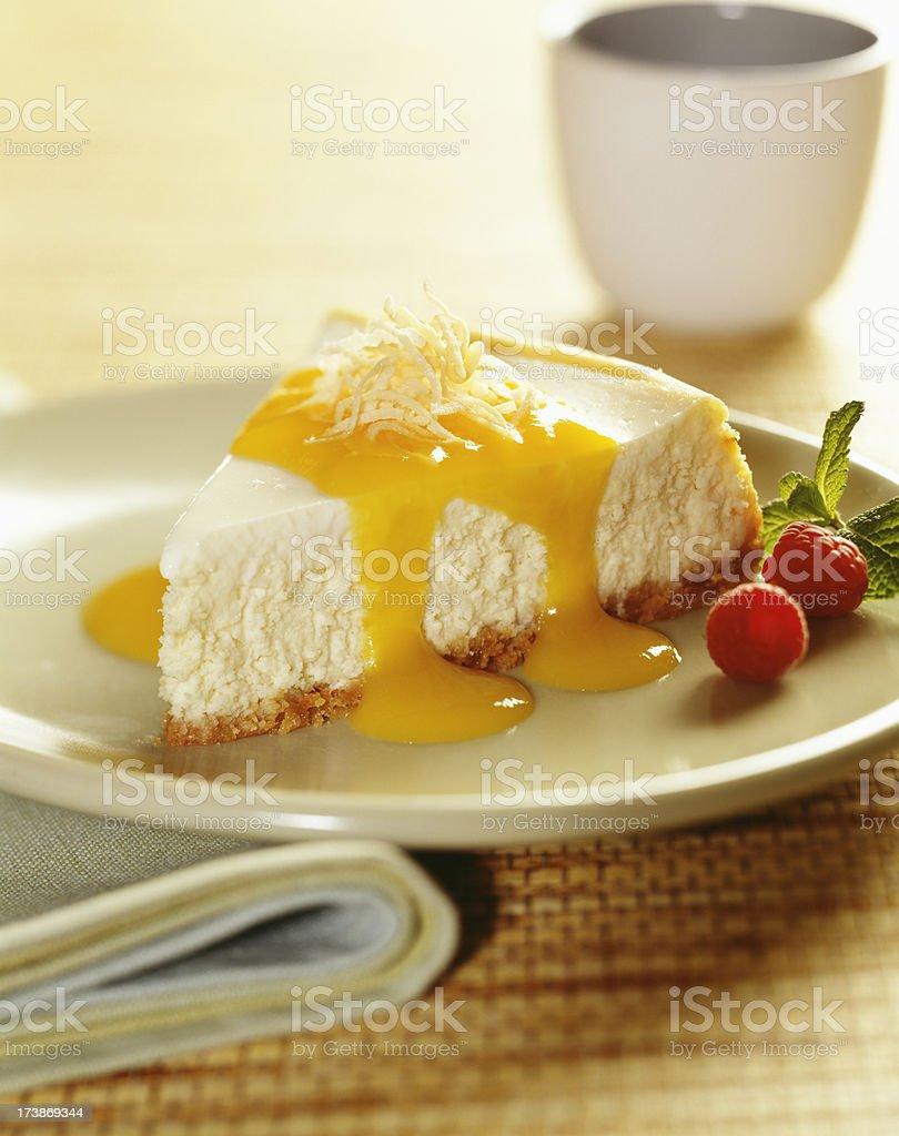 Cheese cake with lemon sauce stock photo
