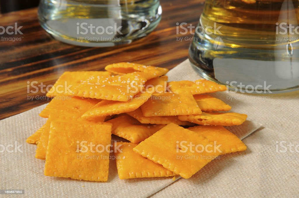 Cheese crackers on a bar counter stock photo