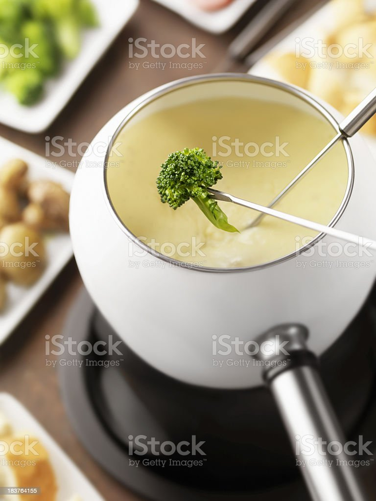 Cheese Fondue with Broccoli stock photo