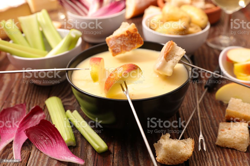 cheese fondue with vegetable,bread,potato stock photo