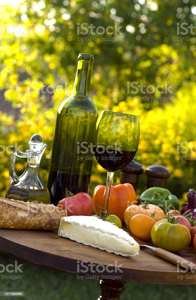 Cheese, French Wine, Fruit, Bread & Vegetables, Gourmet Picnic Food Outdoors stock photo