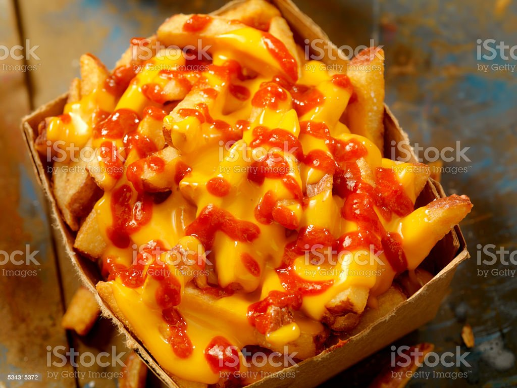 Cheese Fries with Chilli Sauce stock photo