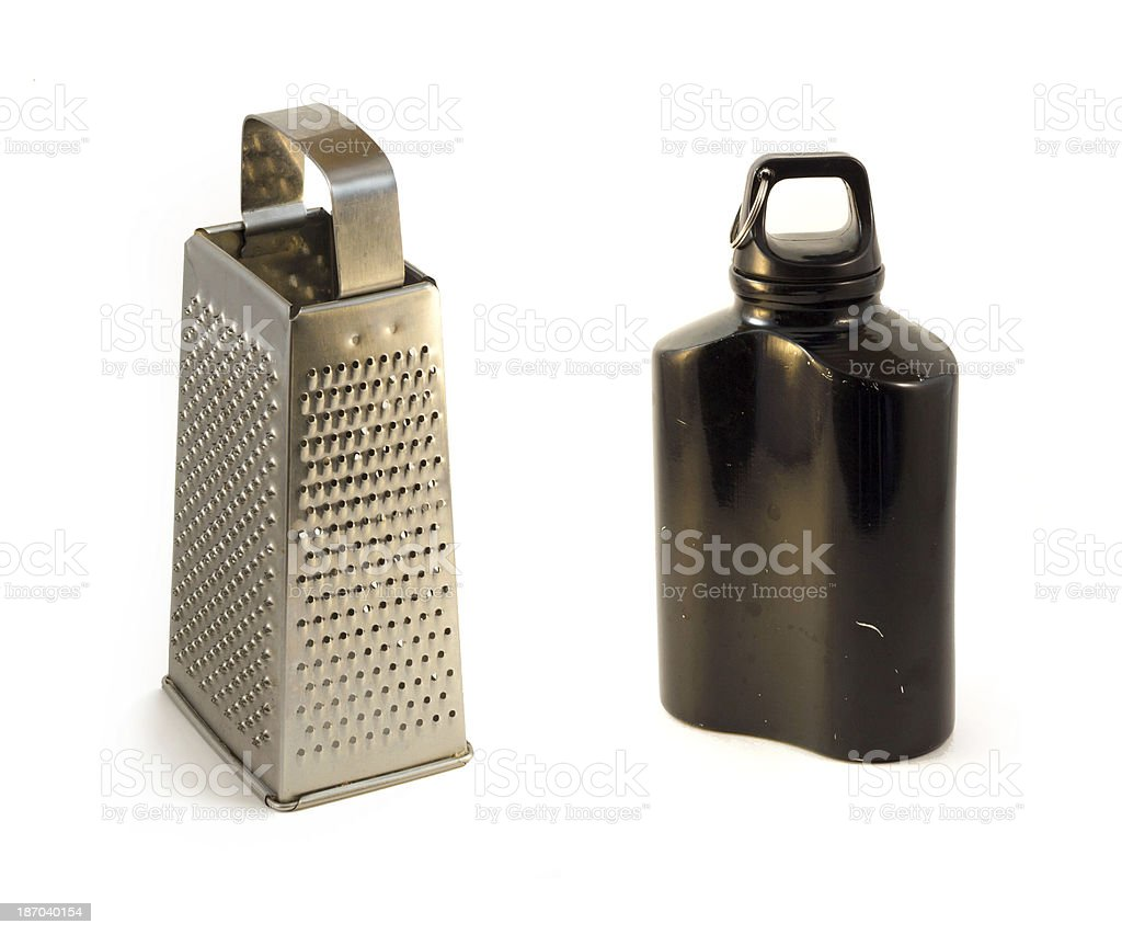 cheese grater and Metal bottle royalty-free stock photo