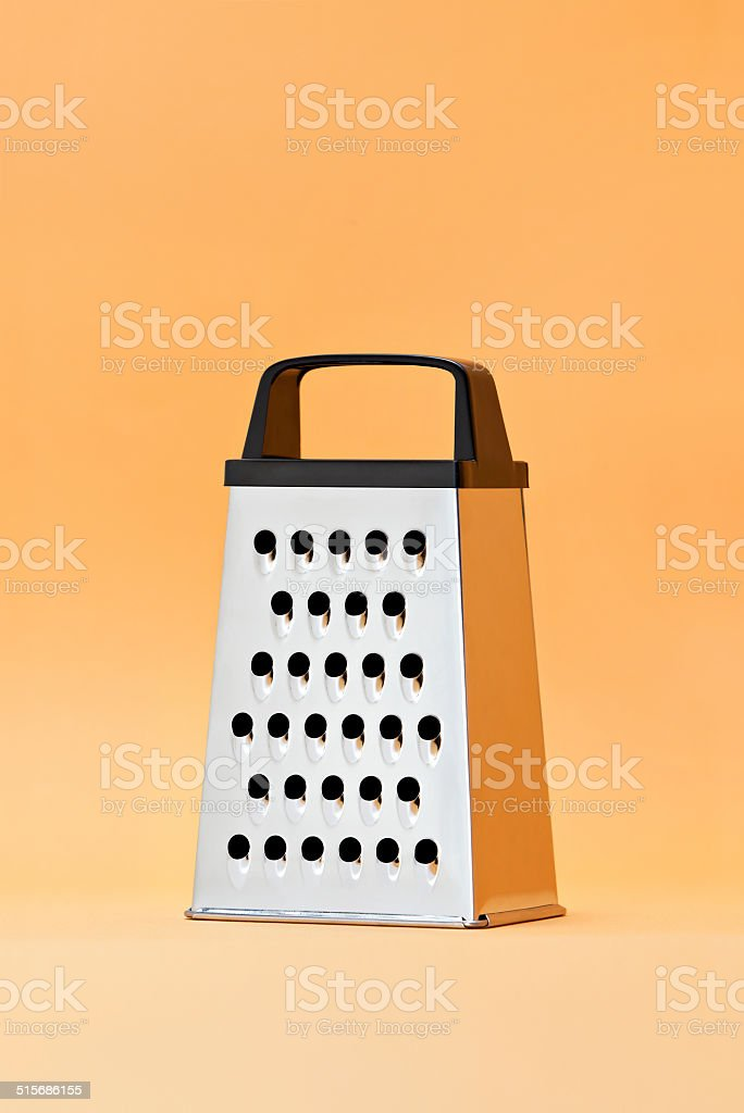 Cheese Grater on Orange Seemless Background stock photo