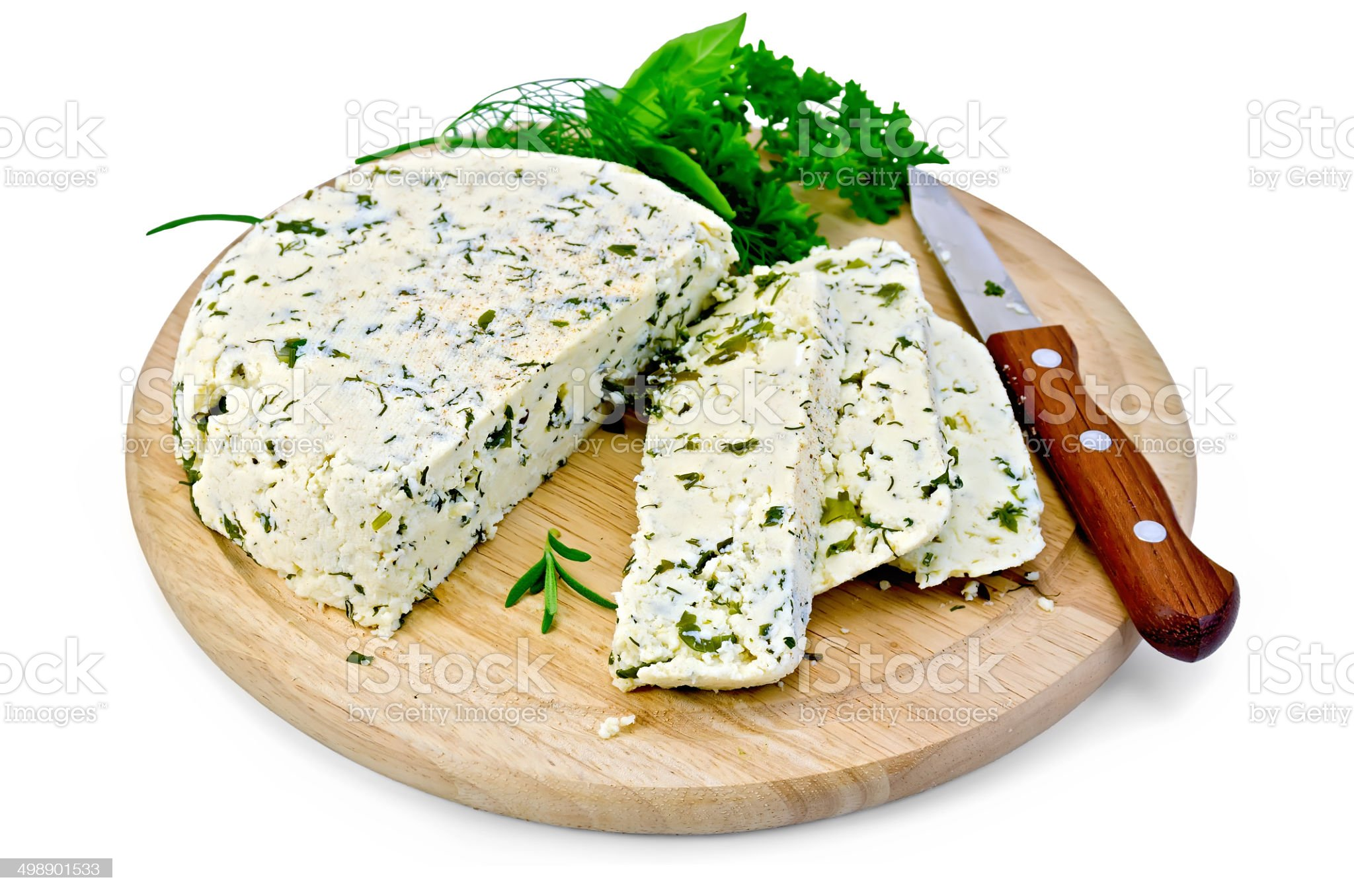 Cheese homemade with spices on a round board royalty-free stock photo