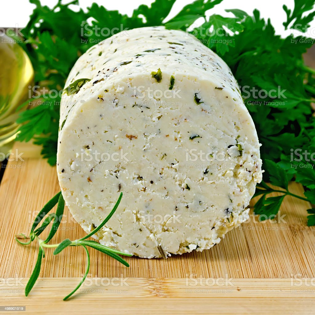 Cheese homemade with spices on board royalty-free stock photo