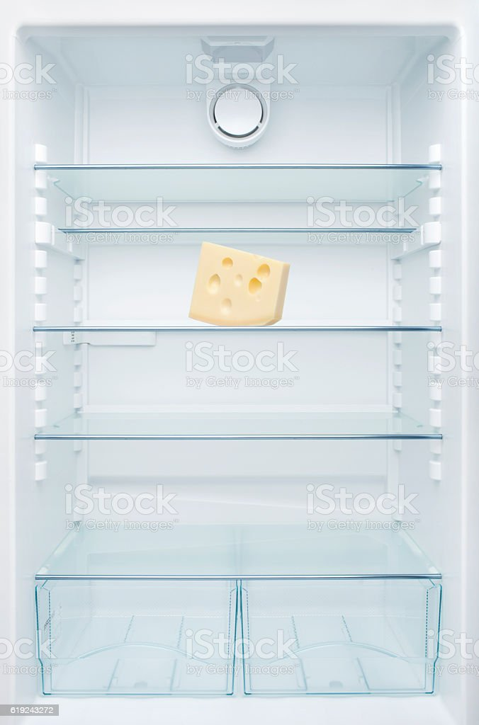 Cheese in an empty fridge stock photo