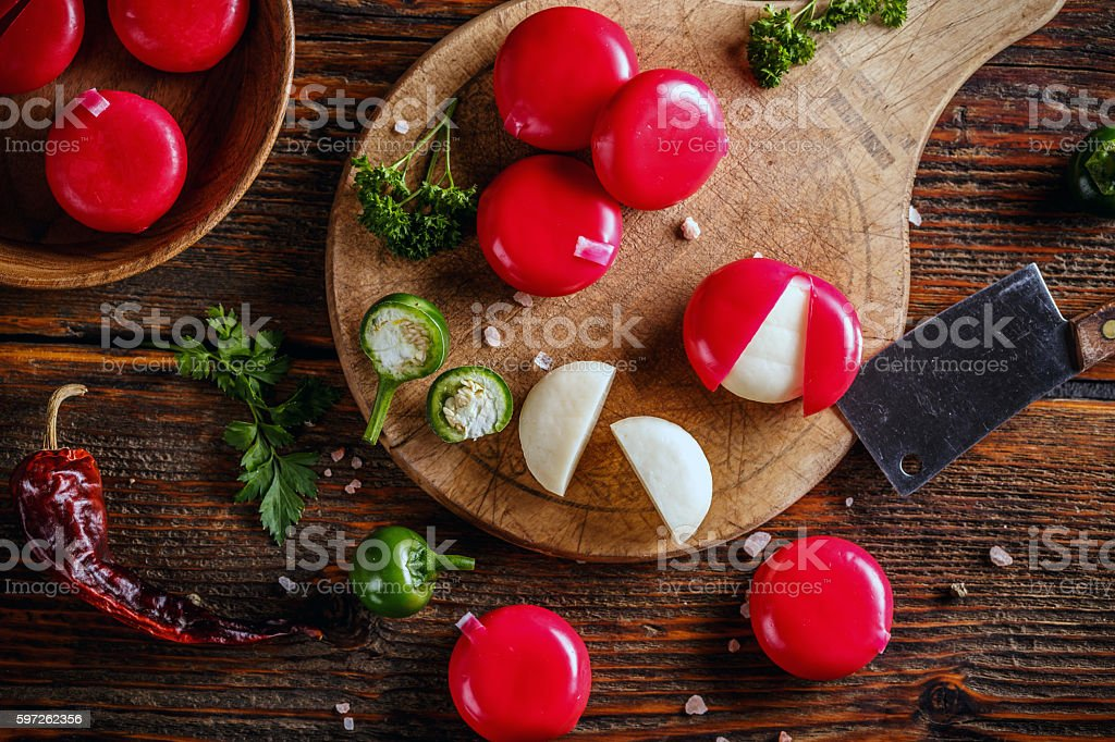 Cheese in red wax stock photo