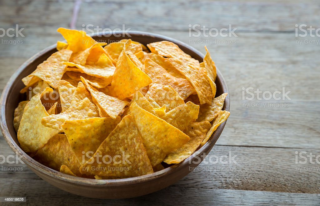Cheese nachos in the bowl stock photo