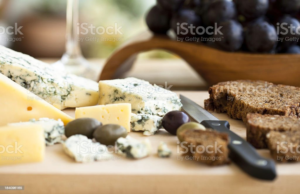 Cheese olives and grapes stock photo