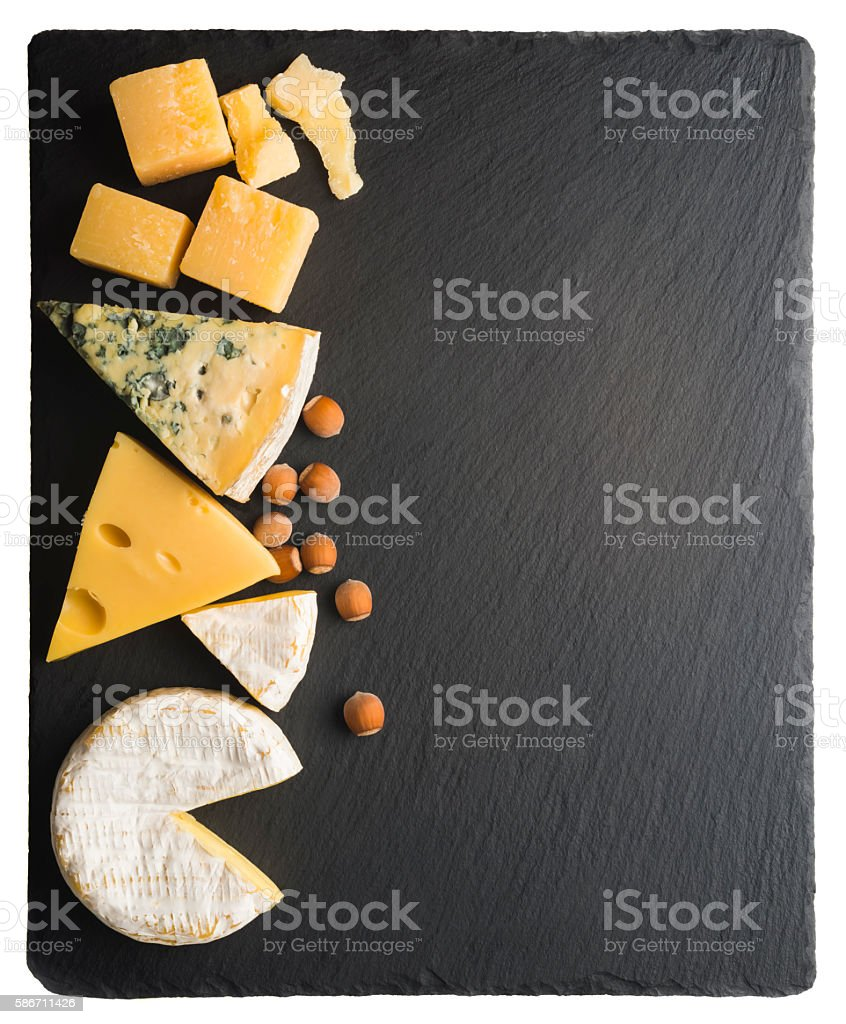 cheese on a black board stock photo