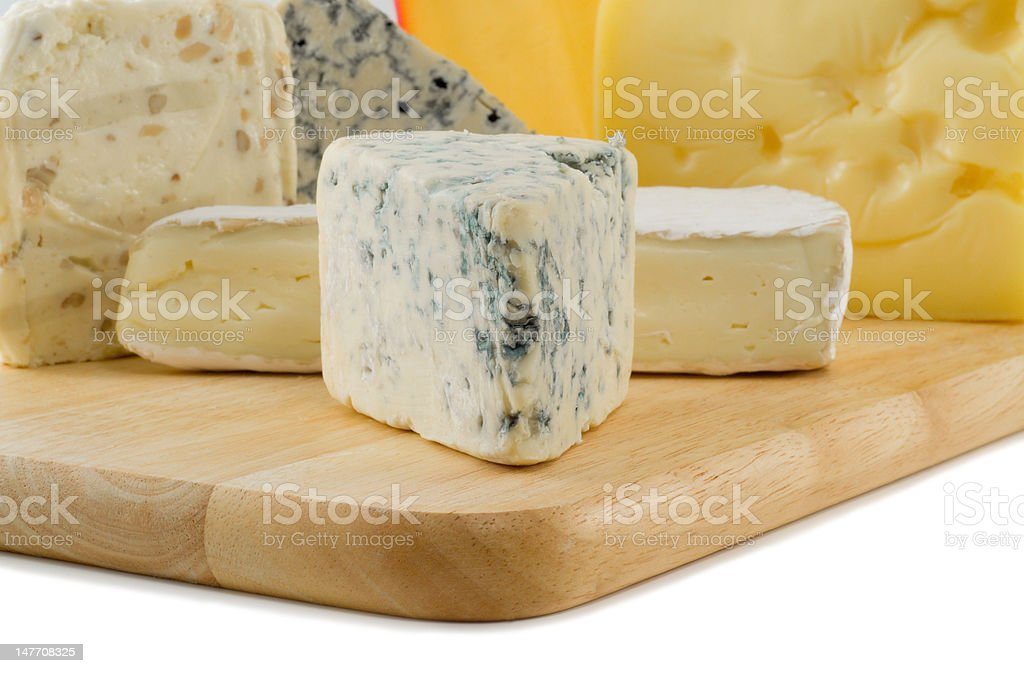 Cheese on a cheeseboard royalty-free stock photo