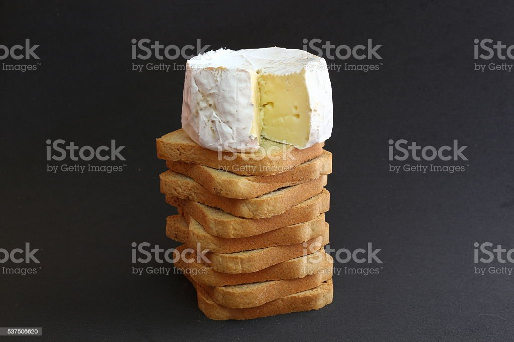 Cheese on a pile of toasts. stock photo