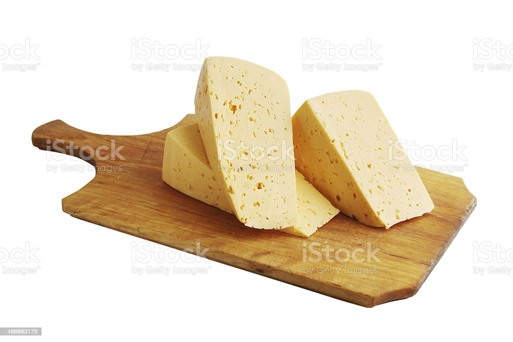 cheese on a wooden board royalty-free stock photo