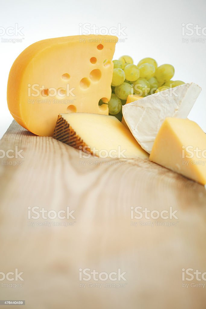 cheese on a wooden table royalty-free stock photo