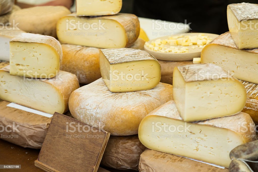 Cheese  on market counter stock photo