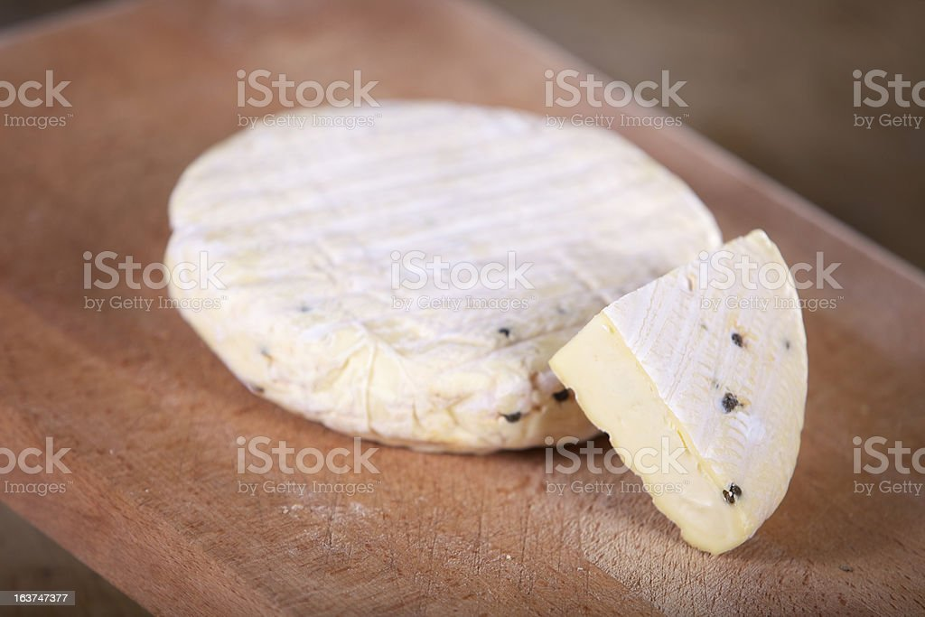 Cheese on wood board royalty-free stock photo