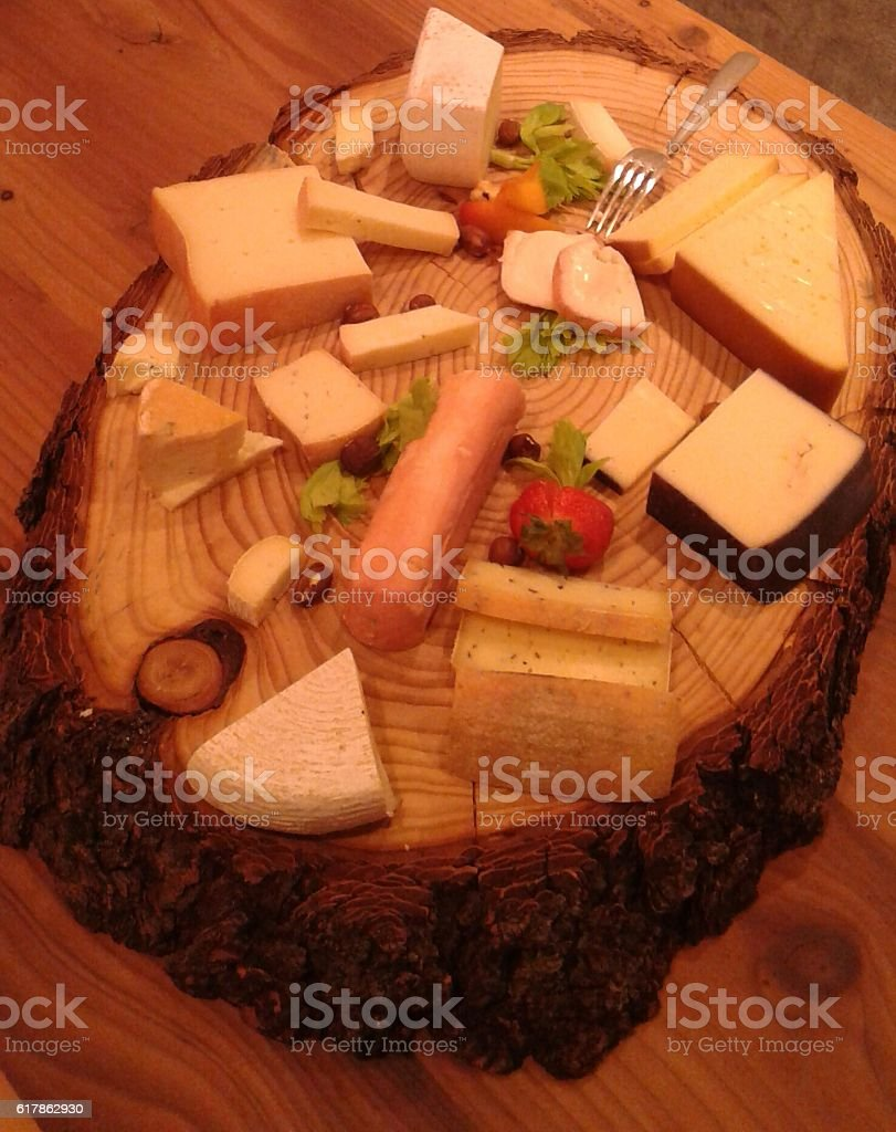 Cheese on wood plate, 2nd od July 2016 stock photo