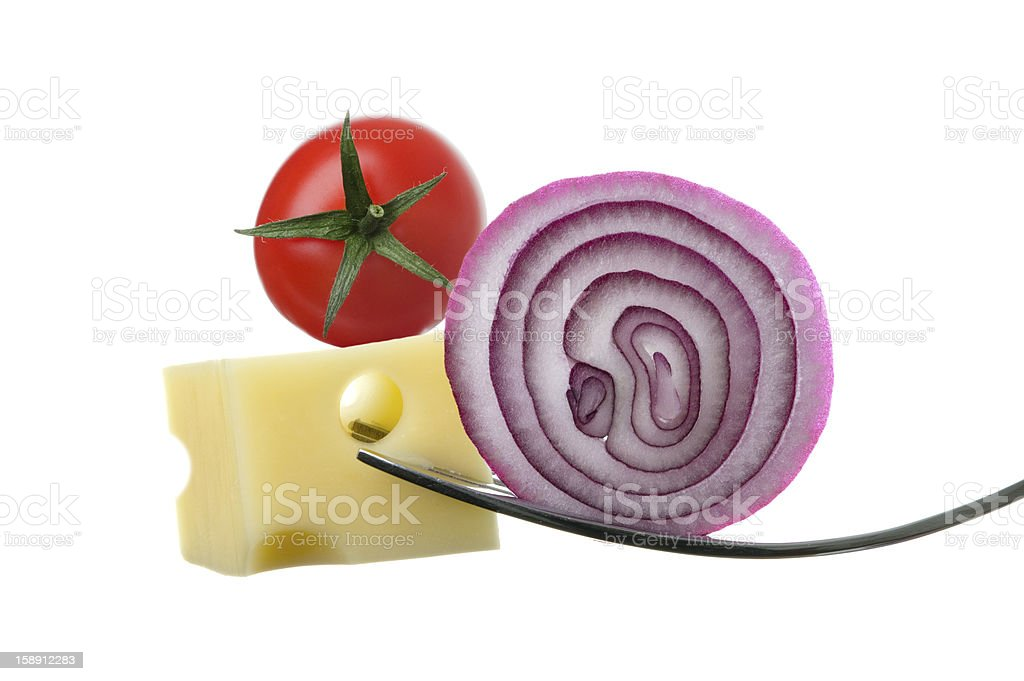 cheese onion and tomato on forks against white royalty-free stock photo