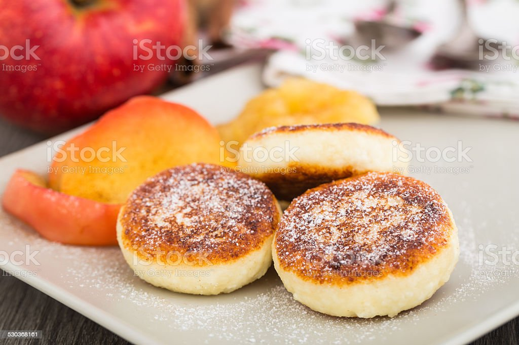 Cheese pancakes with baked apples stock photo