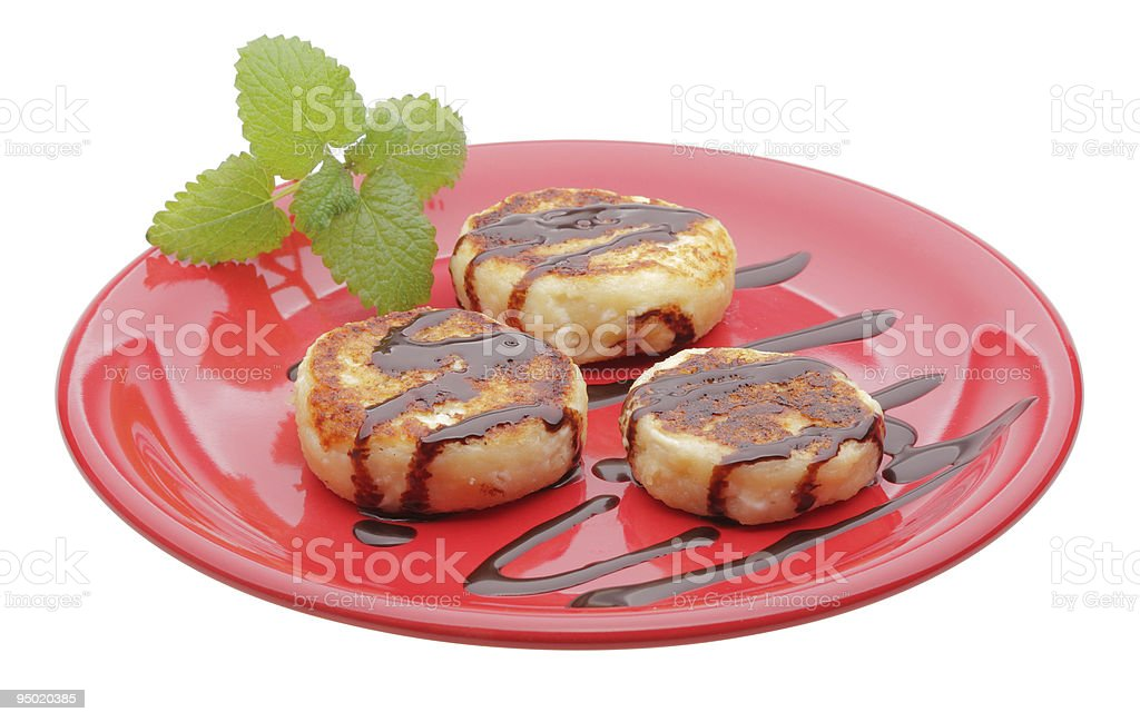 cheese pancakes with chocolate syrup on red plate royalty-free stock photo
