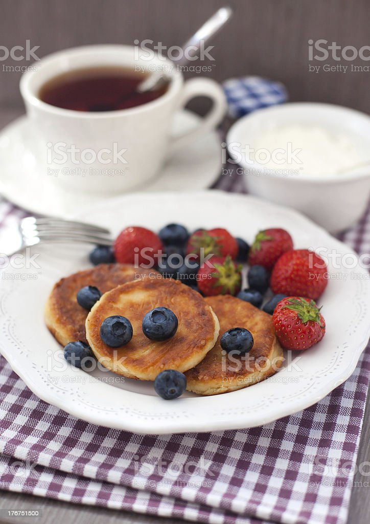 Cheese pancakes with fresh berries royalty-free stock photo