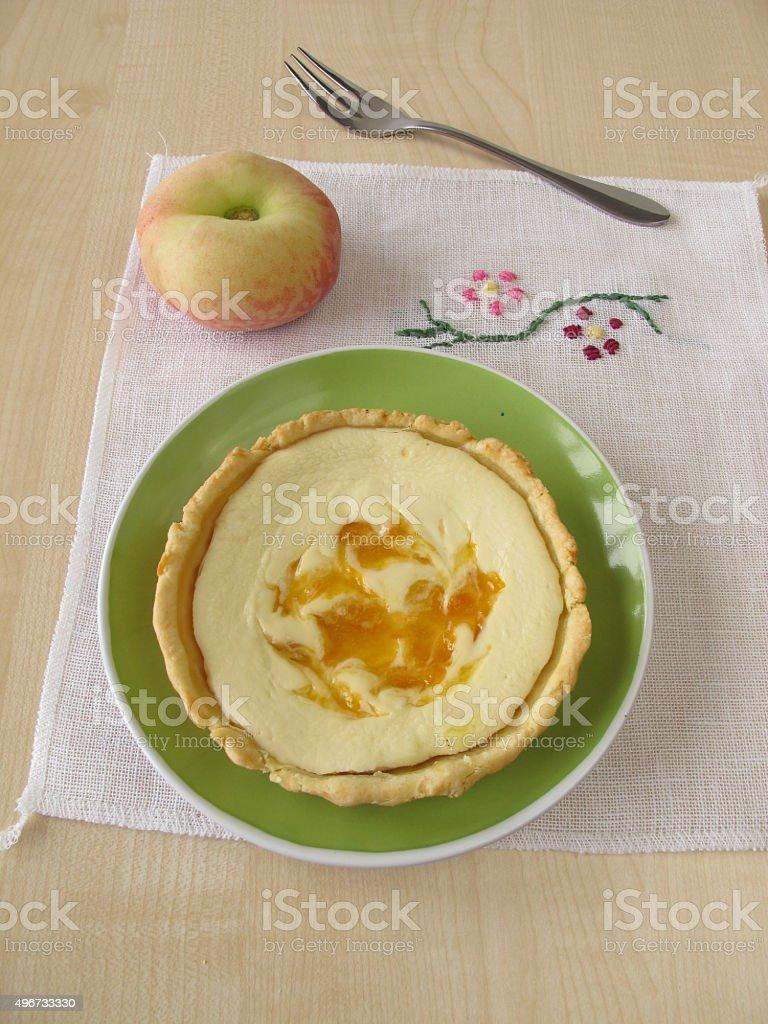 Cheese peach tart on a plate stock photo
