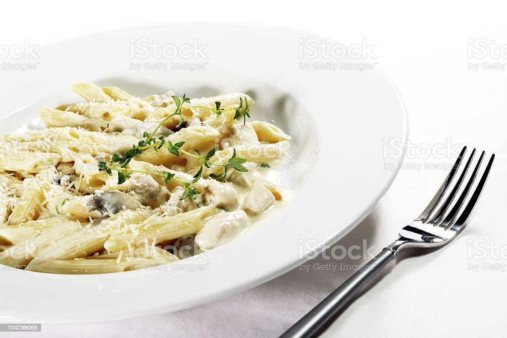 Cheese penne pasta with fork and plate stock photo