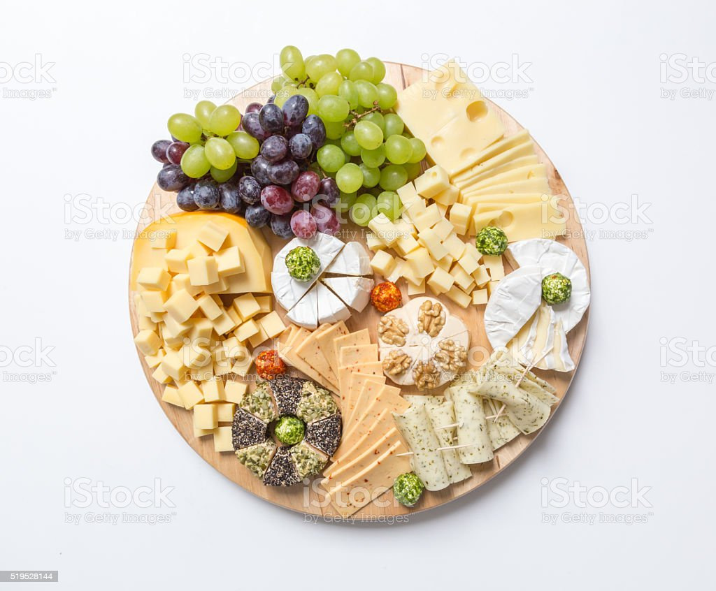 Cheese plate variation on white background stock photo