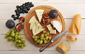 cheese plate - various types of cheeses and figs and