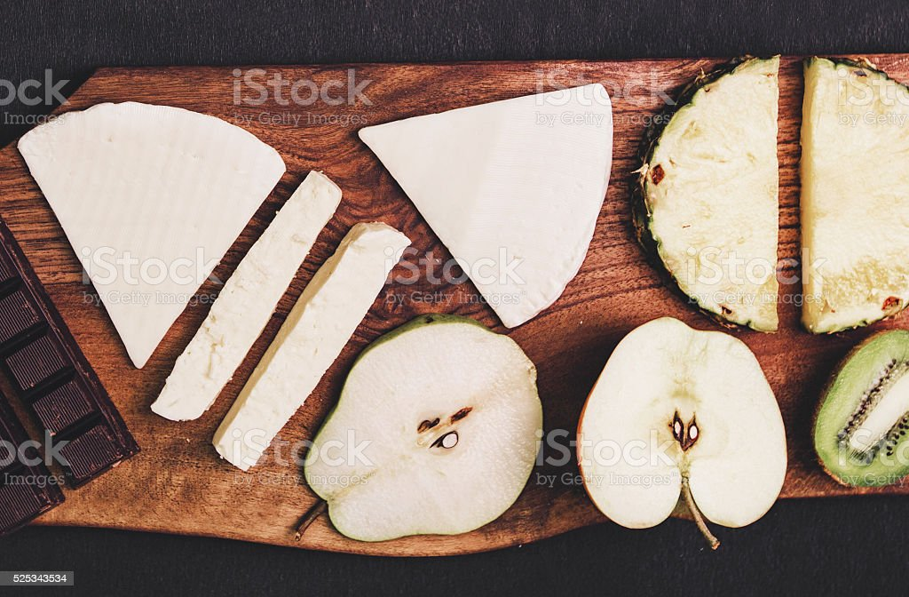 Cheese plate with fruits amd chocolate stock photo