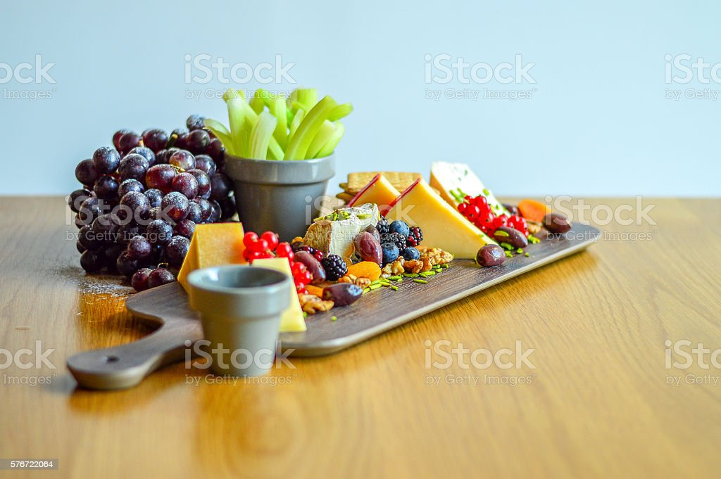 Cheese platter and grapes stock photo