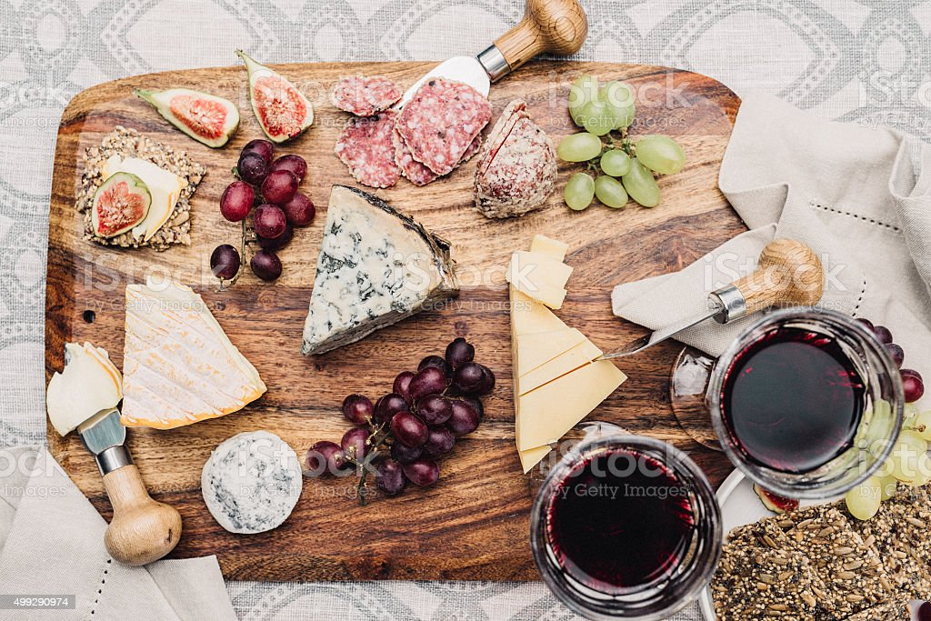 Cheese platter and wine stock photo
