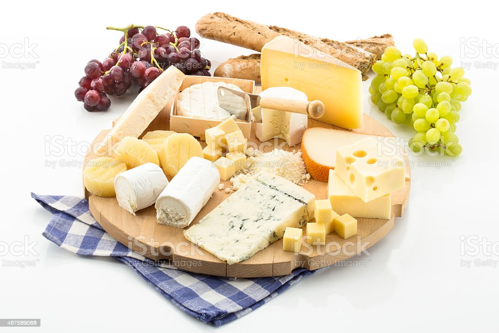 Cheese platter with different cheese and grapes stock photo
